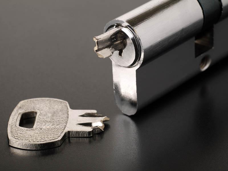 broken key inserted into open lock
